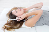 Listening to music whilst laying on the sofa — Stock Photo