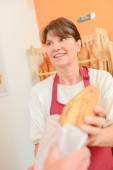 Lady serving bread — Stock Photo