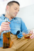 Man has drunk a bit too much whisky — Stock Photo