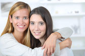 Female friends hugging — Stock Photo