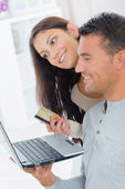Couple shopping on the internet — Stock Photo