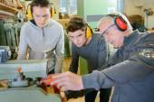 Senior carpenter with two learners — Stock Photo