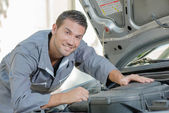 Mechanic stood by a car — Stock Photo