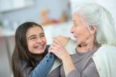 Little girl and grandma whispering secrets — Stock Photo