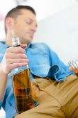Drunk man on his sofa — Stock Photo