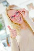 Young blonde seemes happy with her new glasses — Stock Photo