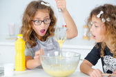 Two little girls having fun baking — Stock Photo