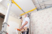 Mason drilling into a ceiling — Stock Photo