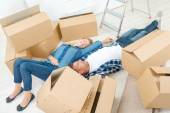 Couple exhausted by house move — Stock Photo