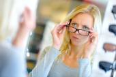 Woman choosing spectacles — Stock Photo