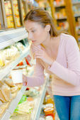 Woman contemplating at chilled counter — Stock Photo