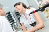 Pouring red wine for couple on a date — Stock Photo