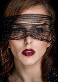 Pretty Woman Face With Net Looking at the Camera — Stock Photo