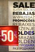 Sale sign in a clothing store window — Stok fotoğraf