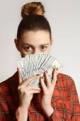 Woman holding dollar bills — Stock Photo