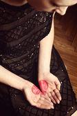 Heart shape drawn on female palms — Stock Photo