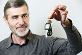 Senior man holding car key — Stock Photo