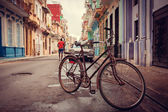 Old bicycle on the street — Stock Photo