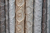 A variety of different bolts of brocade fabric — Stock Photo