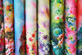 A variety of different bolts of colorful silk fabric — Stock Photo