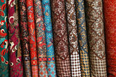 A variety of different bolts of traditional fabric — Stock Photo