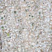 Close up of a dress all covered with shiny white rhinestones — Stock Photo