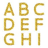 Golden metallic sequins alphabet. — Stock Vector