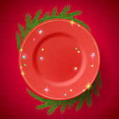 Red plate with christmas tree branches. — Stock Vector