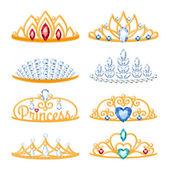 Set of beautyful golden tiaras with gemstones. — Stock Vector