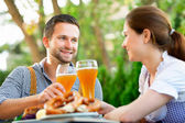 Smiling bavarian couple at Oktoberfest — Stock Photo