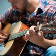 Musician playing acoustic guitar — Stock Photo #52107331