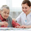 Senior woman with her elder care nurse — Stock Photo #52342075
