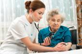 Measuring blood pressure of senior woman — Stock Photo