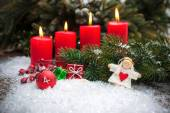 Red candles burning  in snow for fourth advent — Stock Photo
