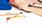 Man laying laminate flooring — Stock Photo
