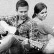 Young couple playing guitar — Stock Photo #53326699