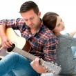 Young couple playing guitar — Stock Photo #53326715