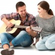 Young couple playing guitar — Stock Photo #53326717