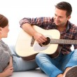 Young couple playing guitar — Stock Photo #53326721