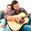 Young couple playing guitar — Stock Photo #53326729