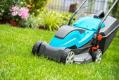 Lawn mower on a green meadow — Foto Stock