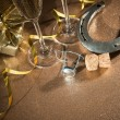 Cork from champagne bottle with a horseshoe — Stock Photo #54219427