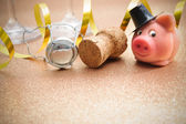 Lucky pig and cork from champagne bottle — Stock Photo