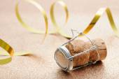 Cork from champagne bottle with streamers — Stock Photo
