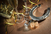 Cork from champagne bottle with a horseshoe — Stockfoto