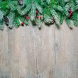 Christmas fir tree on a wooden board — Stock Photo #57524279