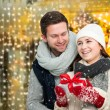 Happy young couple on christmas market — Stock Photo #59153361