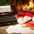 Old typewriter and Santa Claus hat on desk — Stock Photo #59808573