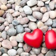 Two red hearts on pebble stones — Stock Photo #61877961