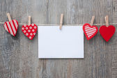 Message and red hearts on the clothesline — Stock Photo